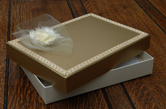 A5 Keepsake presentation gift box. Ivory coloured card box with satin gold finish lid. Gold braiding and ivory chiffon flower to decorate